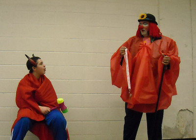 Tiny and former clown (John Jr) perform skit: Don't let Jesus come out of the grave.