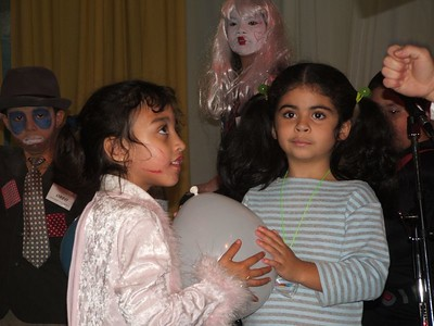 These two girls are ready to bust the balloon containing a Bible question.