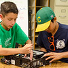 Christopher Barrett and Christian Lucking dissect a VCR at Camp Invention on Wednesday afternoon. The camp is being held at Mary Rowlandson Elementary School for students grades one through six this week in Lancaster. Students will learn through hands-on problem solving using science, technology, engineering and mathematics (STEM). SENTINEL & ENTERPRISE / Ashley Green