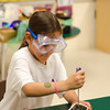 Chiana Bravo, 8, dissects an alarm clock at Camp Invention. The camp is being held at Mary Rowlandson Elementary School for students grades one through six this week in Lancaster. Students will learn through hands-on problem solving using science, technology, engineering and mathematics (STEM). SENTINEL & ENTERPRISE / Ashley Green