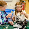 Natalie Davis, 10, and sister Vanessa, 7, dissect a DVD player at Camp Invention. The camp is being held at Mary Rowlandson Elementary School for students grades one through six this week in Lancaster. Students will learn through hands-on problem solving using science, technology, engineering and mathematics (STEM). SENTINEL & ENTERPRISE / Ashley Green