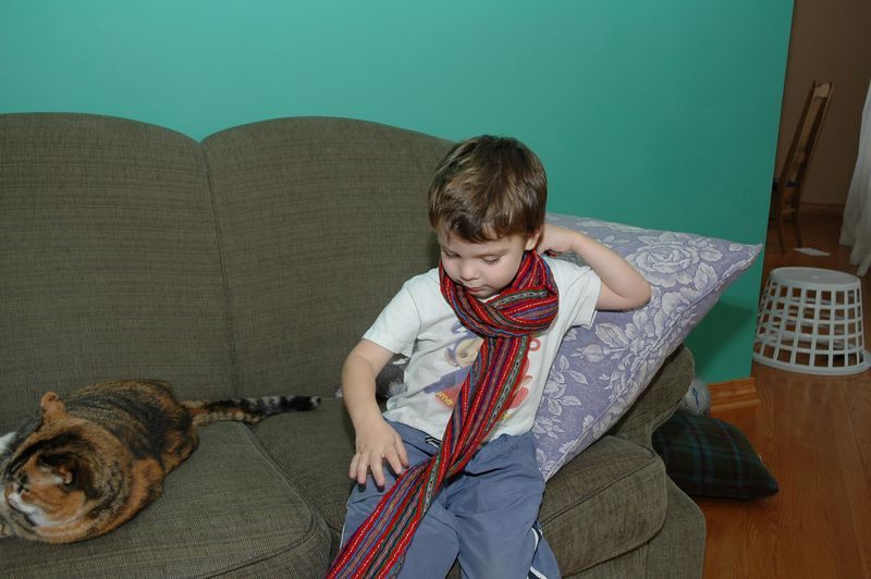 Trying on a scarf from Guatemala