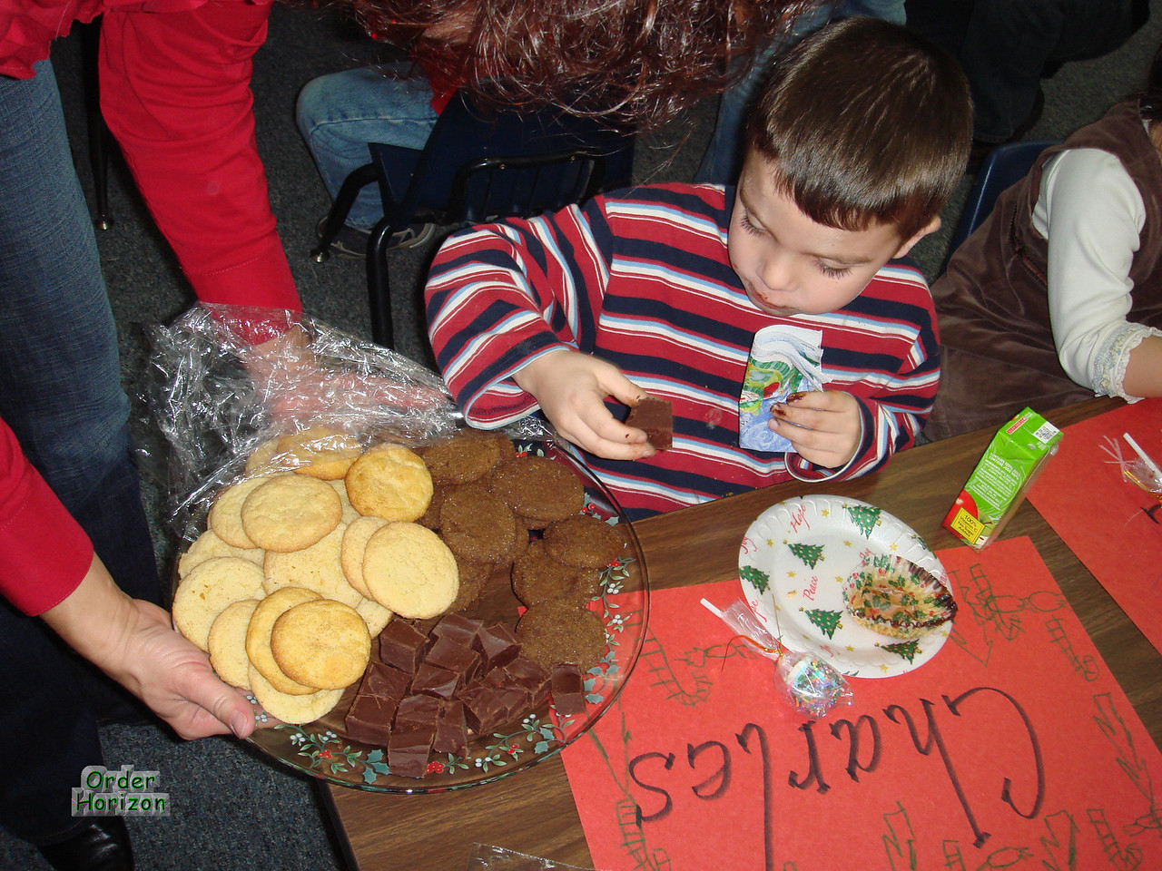 Grabbing some Mom-made cookies at the school party