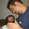 Daddy feeding Chase.  Look at all my pretty hair.
