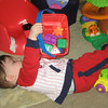 Image 1 of 3.  Chase loves to dump his bucket.  Up...