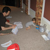 Kenny's trying to change his diaper, but he got away.  Chase really loves playing with the wipes package.