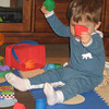 Chase enjoys banging the shapes together.