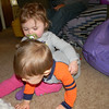 Mariah was trying to give Chase a hug.  He was trying to get away.