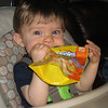 Chase finished his yogurt melts and was having fun playing with the bag.