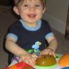 Happy boy enjoying his new activity table.