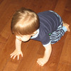 I finally got a pic of his hands while crawling.  This how he crawls.  One hand closed and one hand open.