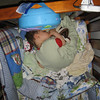 Friday was not a good nap day for Chase.  Notice how he's not actually laying down.  He's leaning forward from a sitting position and fell asleep.  Thank goodness babies are flexible!  He did, however, make a mess of his crib before he finally passed out.  The bumper is in the middle of the crib.