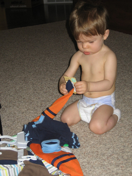 This was Monday morning.  Chase was checking out his new pj's.  He moved up to size 18 months in pj's this week.