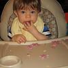 Enjoying blueberry puffs.  Blueberry puffs make a mess!