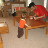Daddy is cleaning Chase's new train table.