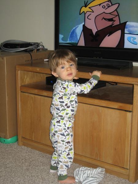 Watching the Flintstone's in his dinosaur pj's.  Oh, and only one sock...