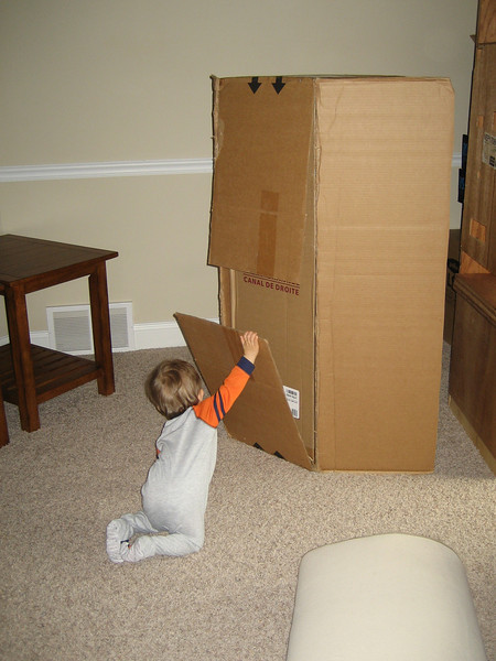 Chase is helping Daddy unpack the tall speakers.  That's so thoughtful!!