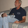 This is Chase's normal position when he sees Grandpa Larry.  snoozing, of course.