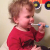 Nana bought Colin his first tooth brush and paste.