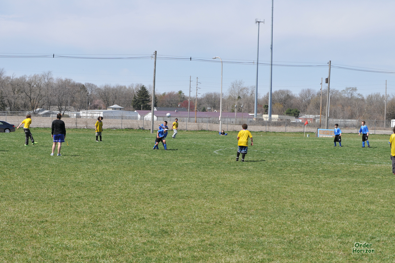 This kick is caught by the opposing goalie.