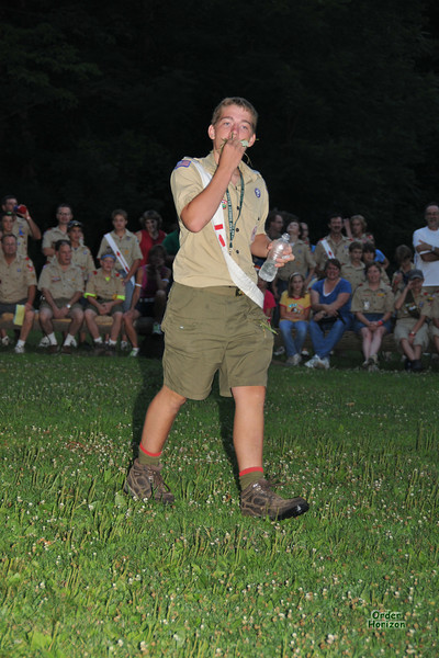 Demonstrating what to eat to survive at Boy Scout Camp (grass, leaves, pond water).