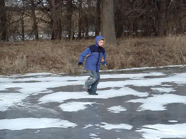 Corwin tries to slide on the pond ice