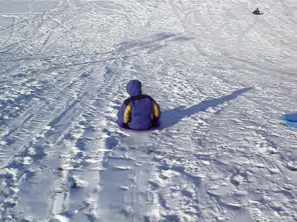Corwin sledding in the saucer