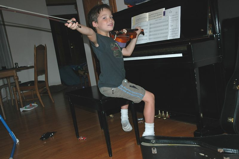 Corwin practices his musical flourishes<br /> (Photo by Charles)