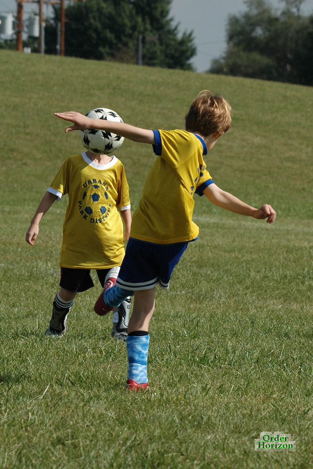 Mackenzie stumbles at the sight of the soccer-headed boy