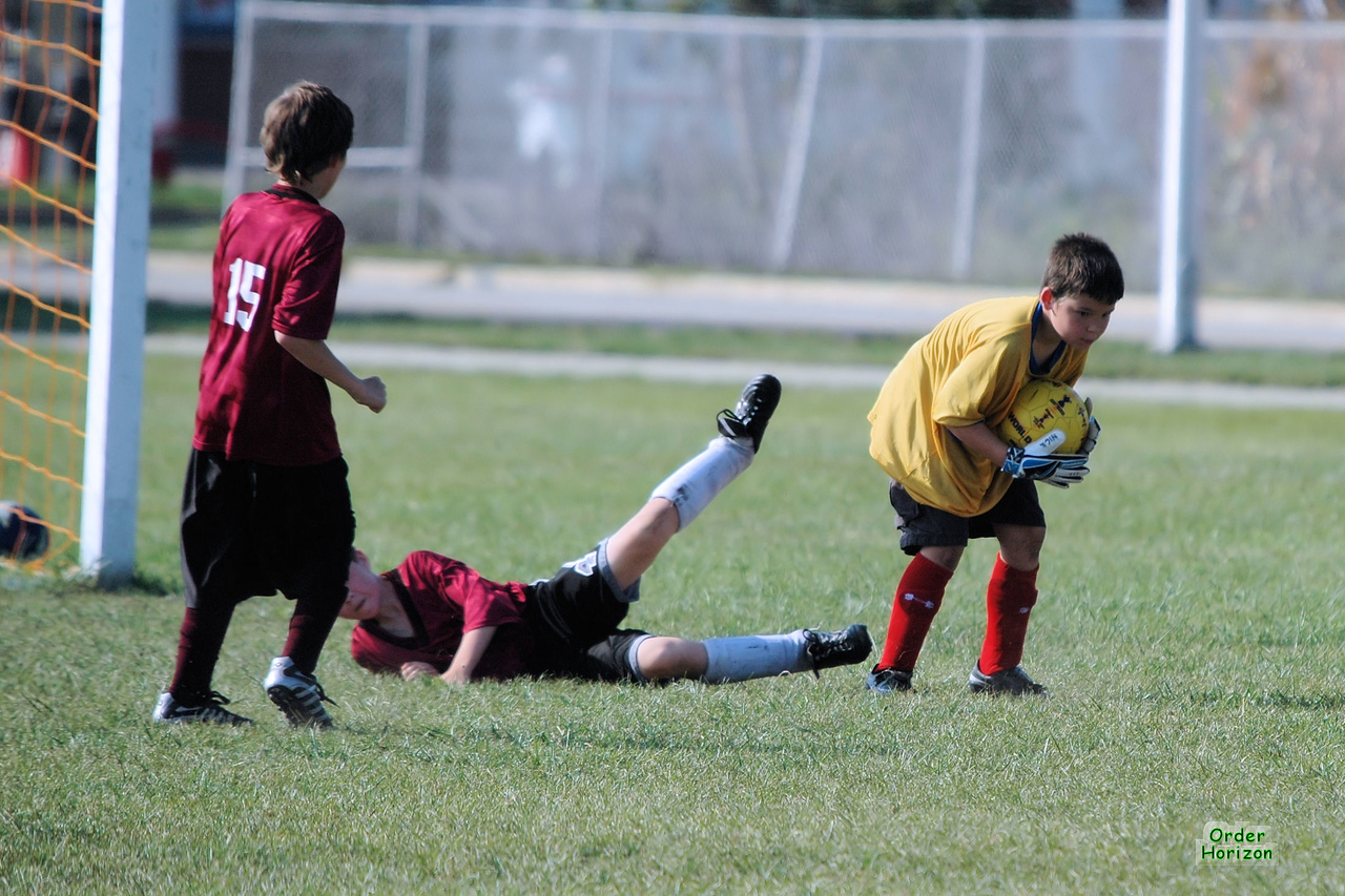 Despite the double team, Corwin leaves his opponents broken on the field
