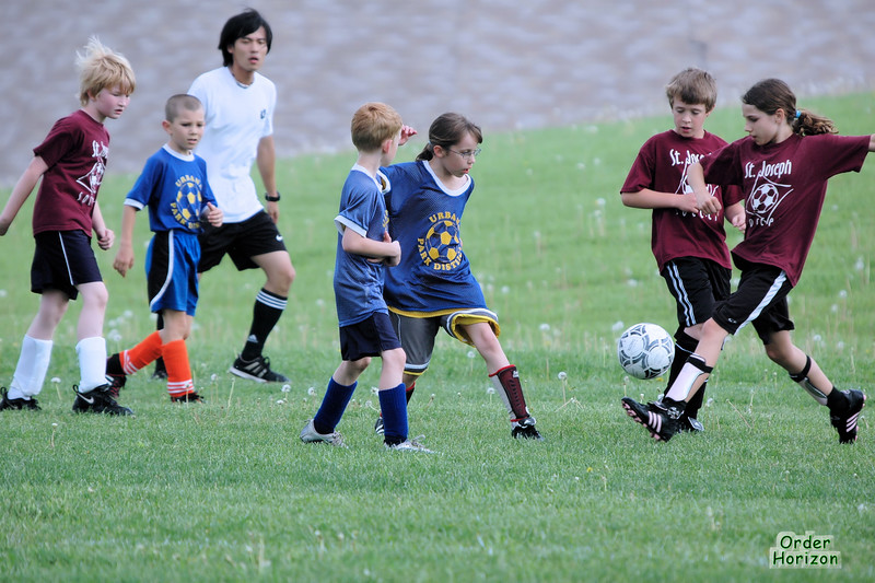 Cora's shorts flare at the scent of an approaching soccer ball