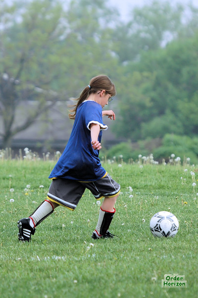 The years of training pay off as Cora uses her soccer-fu to drive the ball downfield