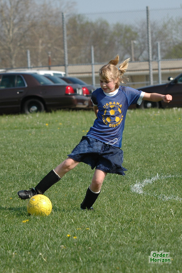 Hair fully deployed, Ali puts the ball in to action