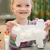 Nolah Lammi, 4, of Ashby, proudly shows off her artwork during a craft hour at the Ashby Free Public Library during a rainy Wednesday afternoon. SENTINEL & ENTERPRISE / Ashley Green