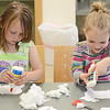 Cousins Elina Woodard, 5, and Nolah Lammi, both of Ashby, during a craft hour at the Ashby Free Public Library during a rainy Wednesday afternoon. SENTINEL & ENTERPRISE / Ashley Green