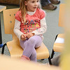Ryleigh Pennell, 4, of Ashby, listens to a story at the Ashby Free Public Library during a rainy Wednesday afternoon. SENTINEL & ENTERPRISE / Ashley Green