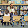 Assistant Librarian Jeanie Lindquist reads a story to a group of preschoolers at the Ashby Free Public Library during a rainy Wednesday afternoon. SENTINEL & ENTERPRISE / Ashley Green