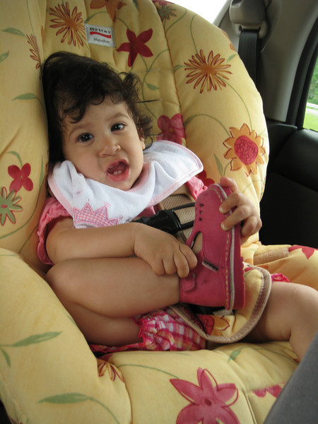 Cozy in her car seat.