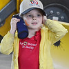 Allison Clark, 5, of Gardner, covers her ears during DPW Day on Wednesday afternoon. The event was put on by the Fitchburg Department of Public Works and ACE of Central MA. SENTINEL & ENTERPRISE / Ashley Green