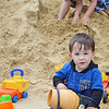 William Boucher, 2, of Fitchburg, plays in the sand during DPW Day on Wednesday afternoon. The event was put on by the Fitchburg Department of Public Works and ACE of Central MA. SENTINEL & ENTERPRISE / Ashley Green