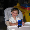 Joey-in-highchair-with-glass-of-milk-9-15-04