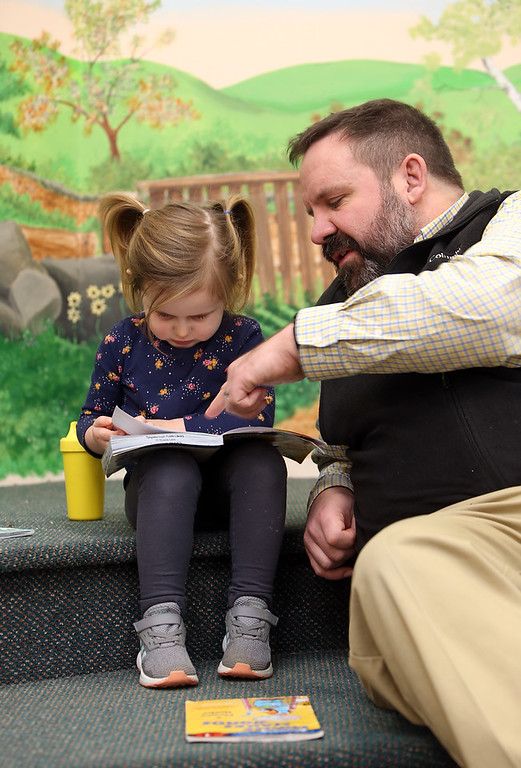 . Dads & Donuts free play time with snacks at Tyngsborough Public Library. Madison Melville, 4, and her father Justin Melville, of Dracut. (SUN/Julia Malakie)