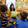 Marites MacLean reads a story to her day care students at Children First Family Childcare in Fitchburg on Friday afternoon. SENTINEL & ENTERPRISE / Ashley Green