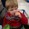 Eating crackers and making a mess doing it while in the shopping cart at Wal-Mart.