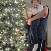 A little help from Daddy so all the ornaments aren't on one area.