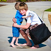 Ethan Moody (apprentice photographer assistant) embraces Dougy during a fun photo shoot!