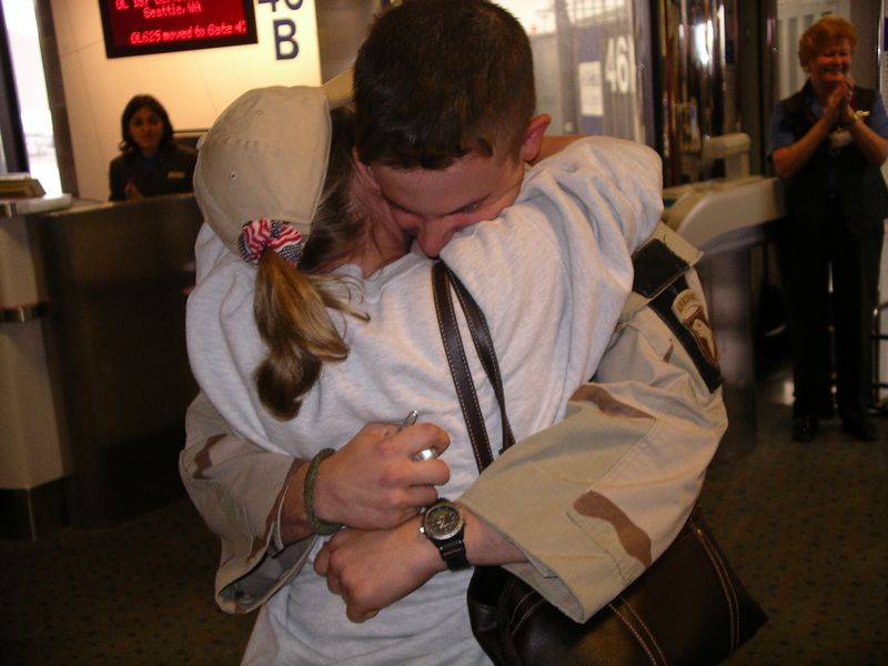 Coming off the plane Oct 14 2005 in Newark. There were 2 other solders on the flight with him and when each one came off the terminal erupted in clapping and thank-you's.