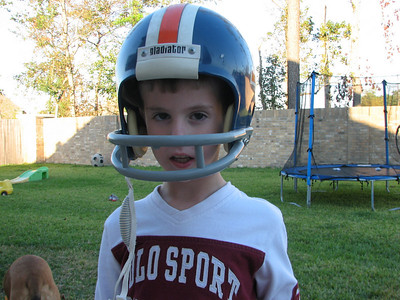 "Tyler absolutely loves football right now.  This is Sean's helmut from when he was a kid.  It's a Denver Broncos helmet.  And everyday when we get ready to go outside, Tyler says ""D"" (because there's a big D on the helmet).  He likes to go out and kick the football.  Loves this helmet!"