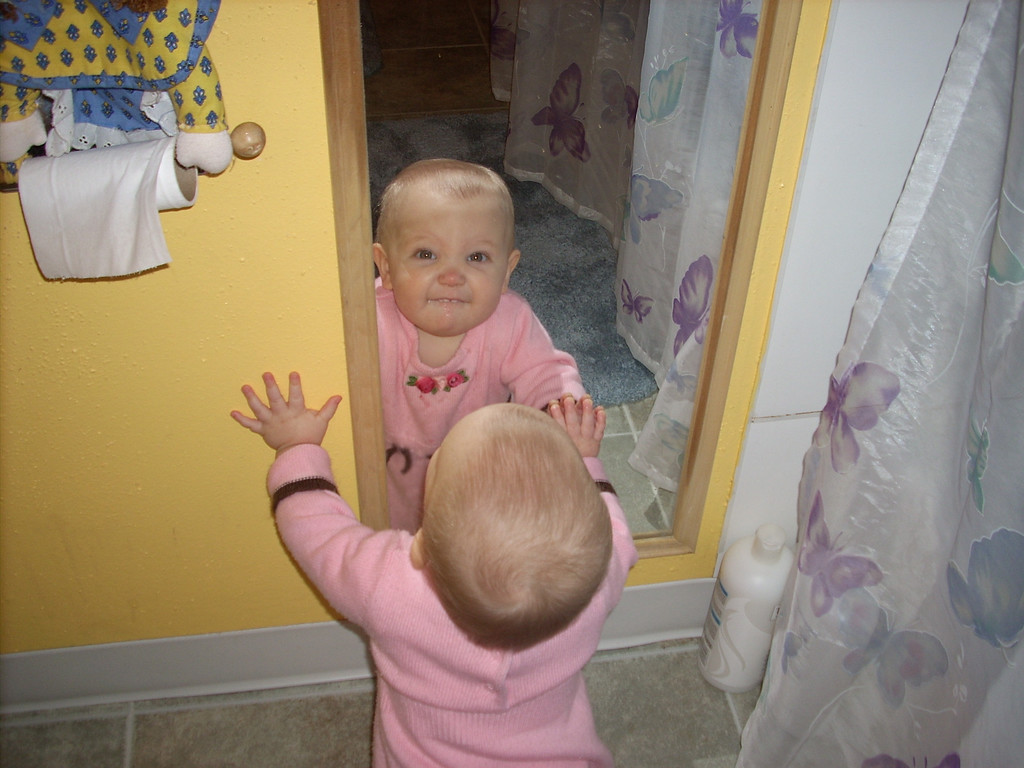 The classic baby in the mirror photo.