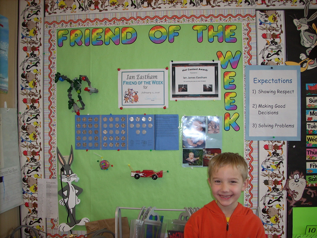 Ian in front of his friend of the week poster. He was so excited about bringing in his stuff for the board.